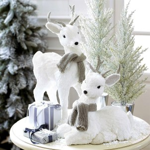 holidaydecor08 White reindeer: $34.95 each. from Pier1
